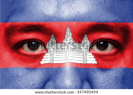 Human face painted with flag of Cambodia.