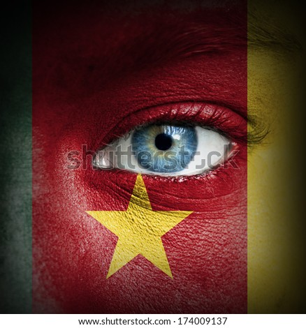 Human face painted with flag of Cameroon