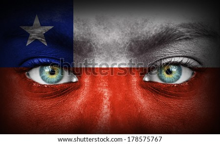 Human face painted with flag of Chile