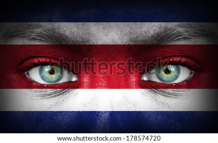 Human face painted with flag of Costa Rica