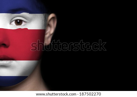 Human face painted with flag of Costa Rica - stock photo