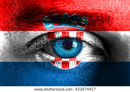 Human face painted with flag of Croatia