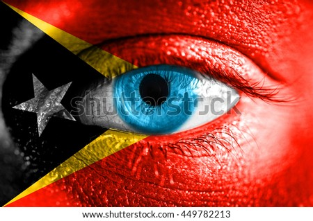 Human face painted with flag of East Timor