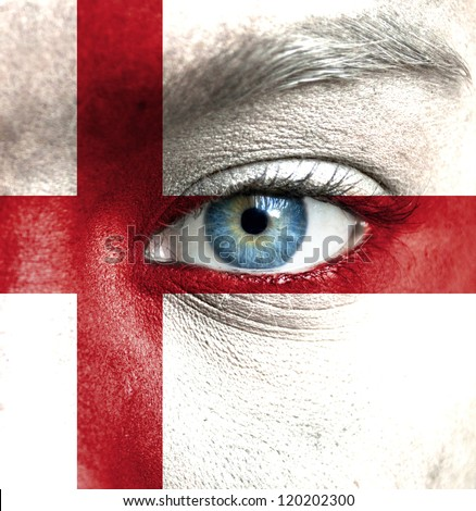 Human face painted with flag of England - stock photo