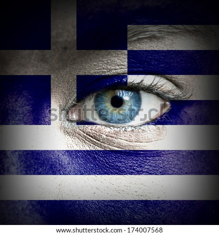 Human face painted with flag of Greece - stock photo