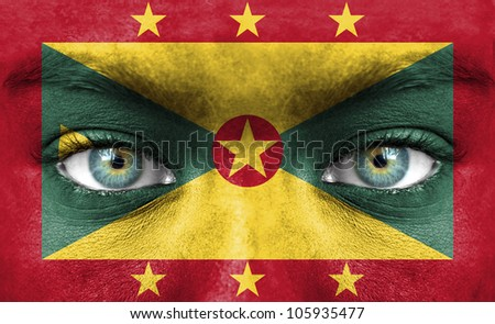 Human face painted with flag of Grenada