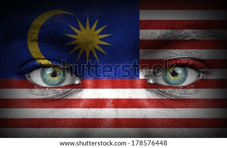 Human face painted with flag of Malaysia