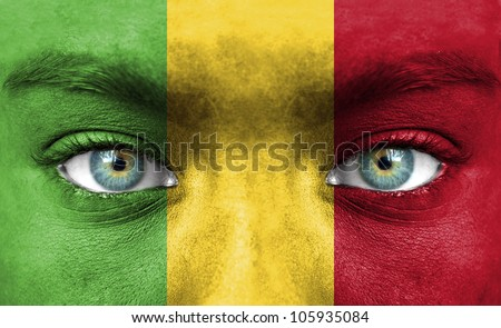Human face painted with flag of Mali