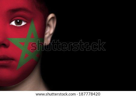 Human face painted with flag of Morocco - stock photo