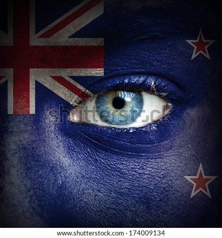 Human face painted with flag of New Zealand - stock photo