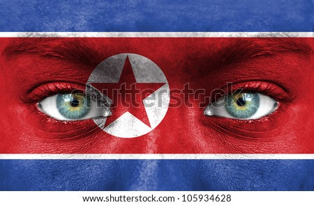 Human face painted with flag of North Korea