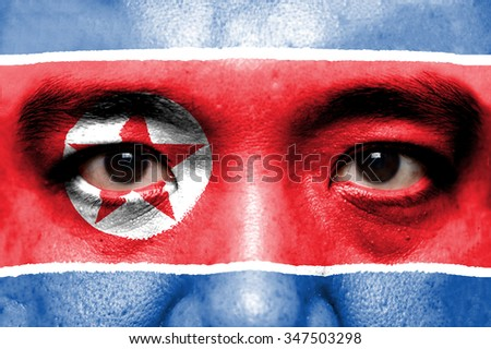 Human face painted with flag of North Korea.
