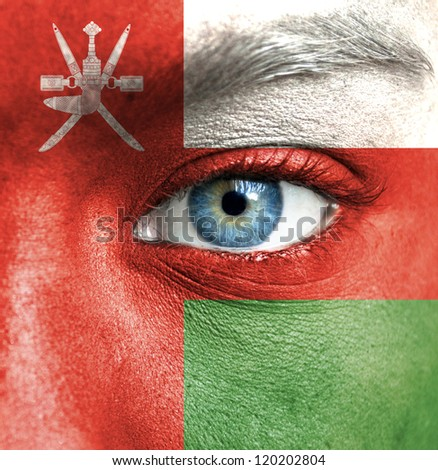 Human face painted with flag of Oman