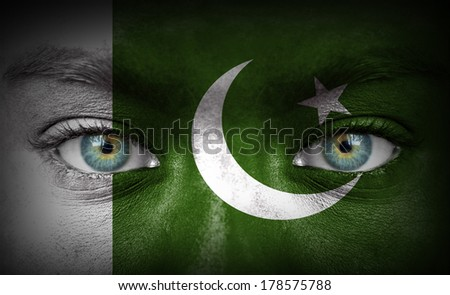 Human face painted with flag of Pakistan - stock photo