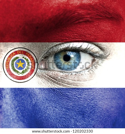 Human face painted with flag of Paraguay