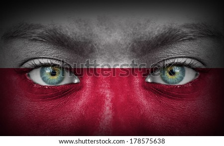 Human face painted with flag of Poland - stock photo