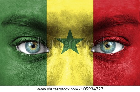 Human face painted with flag of Senegal