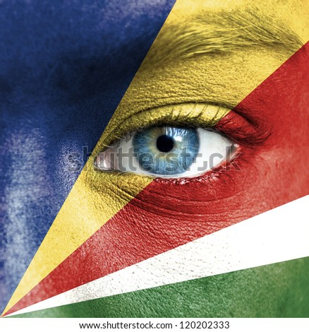 Human face painted with flag of Seychelles
