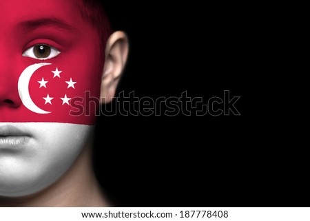 Human face painted with flag of Singapore - stock photo