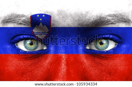 Human face painted with flag of Slovenia