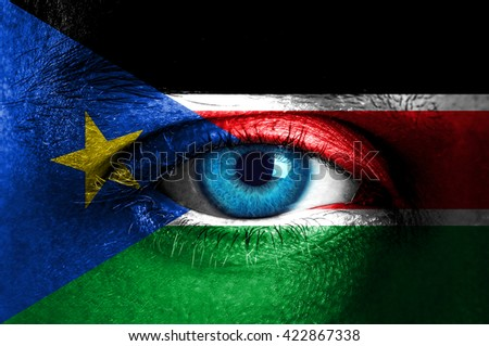 Human face painted with flag of South Sudan