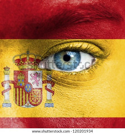 Human face painted with flag of Spain - stock photo
