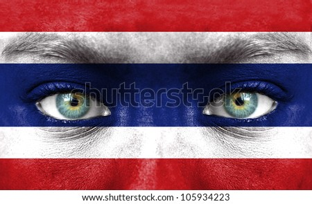 Human face painted with flag of Thailand