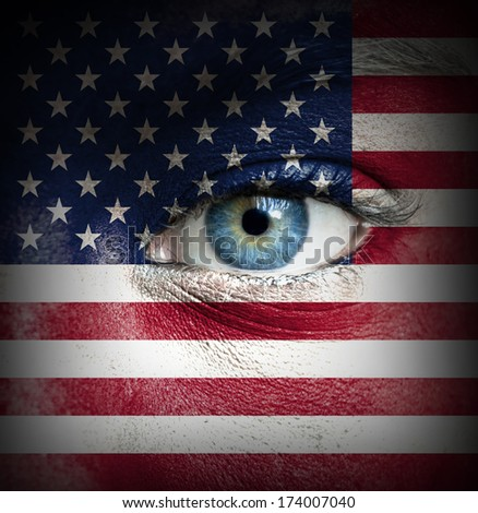 Human face painted with flag of United States of America - stock photo