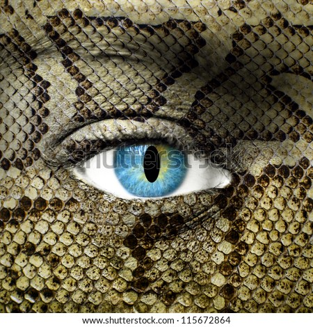 Human face with snake skin texture - stock photo
