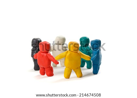 human figures from clay stand in a circle. isolated background - stock photo
