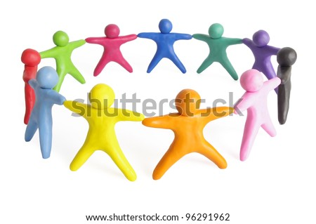 human figures from plasticine stand in a circle - stock photo