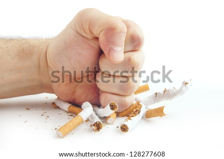 Human fist breaking cigarettes Anti smoking concept