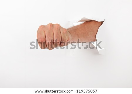 Human fist through the broken wall