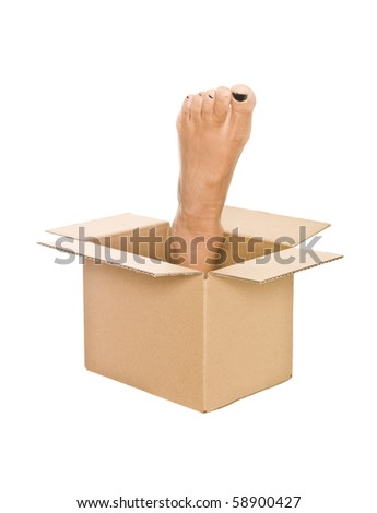 Human foot in a cardboard box isolated on white background