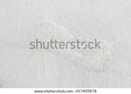 Human footprint on white cement floor  - stock photo