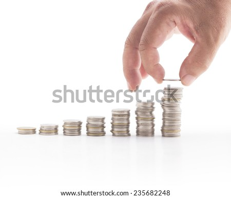 Human Hand Adding Coin concept. Row Money Fund Debt Rate Save Stack Graph Steps High Rich Profit Cash Market Bank Stock Loan Idea Put Scale Top Up Earn Trust Arm Success Wealth Business Silver Tower - stock photo