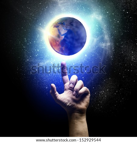 Human hand and earth planet. Ecology concept. Elements of this image are furnished by NASA - stock photo
