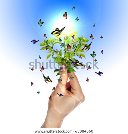 Human hand and multicolored butterflies, grass and a symbol of the environment. Collage. - stock photo