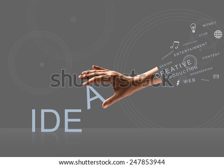 Human hand connecting letters of word idea - stock photo