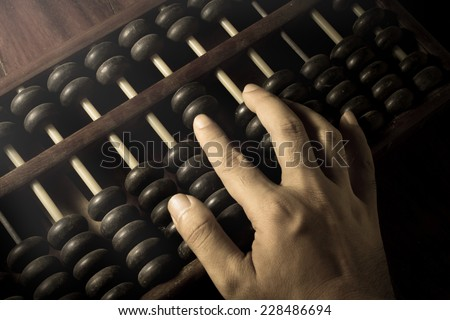 Human hand counting with abacus.  - stock photo