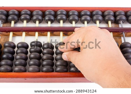 Human hand counting with wooden abacus beads. - stock photo