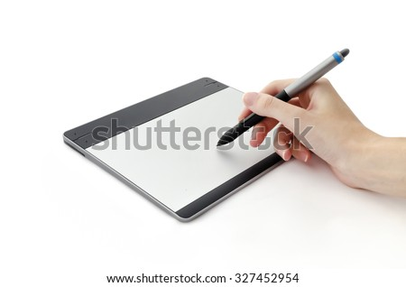 Human hand drawing on interactive graphics tablet isolated on white background