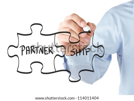 Human hand drawing partnership puzzle on the transparent whiteboard - stock photo