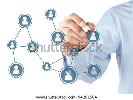 Human hand drawing social network scheme on the whiteboard - stock photo