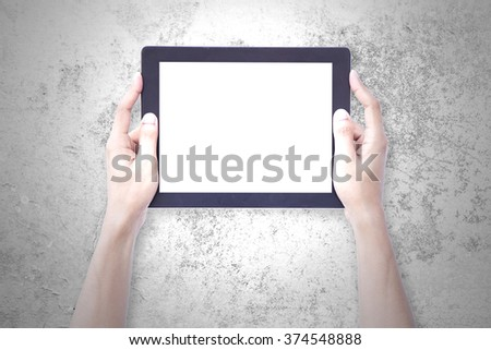 Human Hand Hold Tablet over vintage wall background. - stock photo