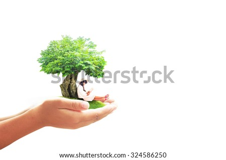 Human hand holding a beautiful asian girl reading a book under big tree on green meadow isolated on white background. World Mental Health Day concept. International Day of the Girl Childconcept. - stock photo