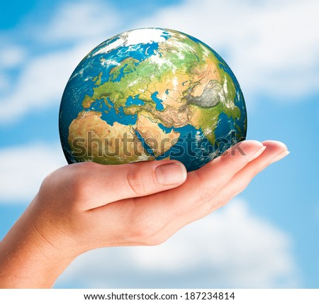 Human hand holding a globe.  - stock photo