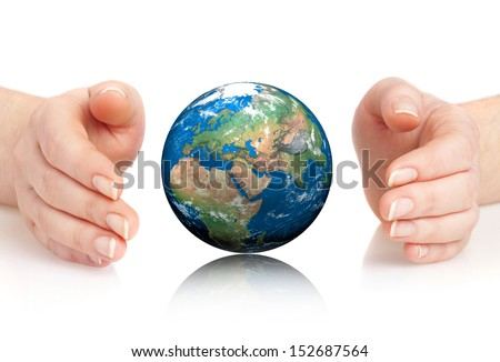 Human hand holding a globe isolated on a white background. Elements of this image furnished by NASA. - stock photo