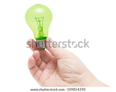 human hand holding a green bulb on a white background - stock photo