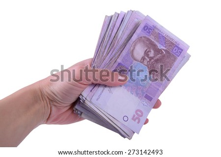 human hand holding a lot of Ukrainian hryvnia currency isolated on white